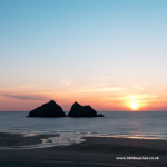 Sunset over Holywell Bay beach and Gull Rocks in North Cornwall