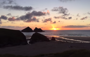 sunset time-lapse Holywell Bay beach, Newquay Cornwall