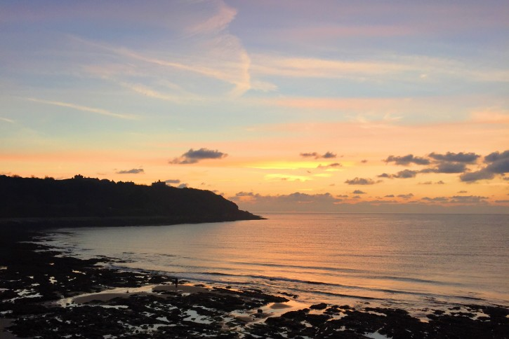 Sunrise in Falmouth over castle beach and Pendennis Point.