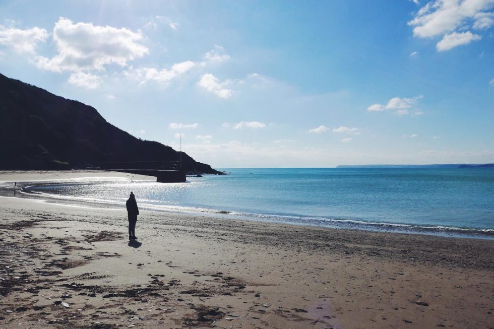 sunny morning on Polkerris Beach in south east cornwall