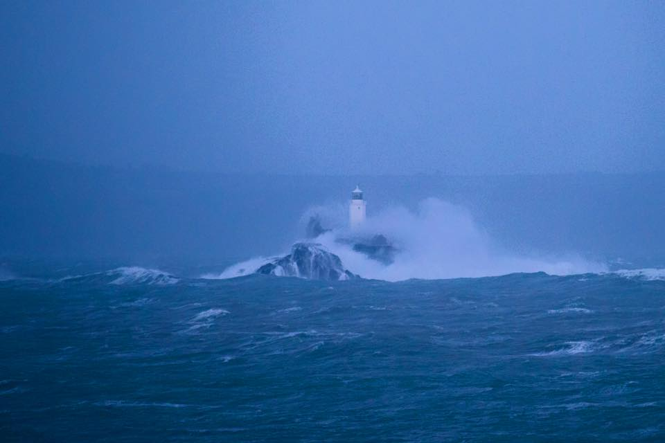 Gwithian lighthouse being pounded by storm imogen - photo © Beachmuser