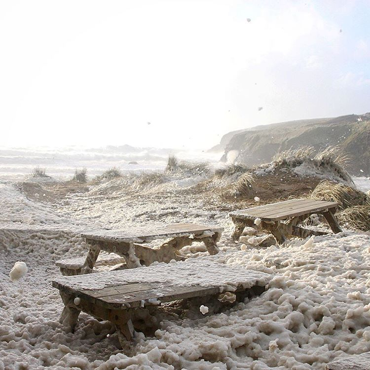 Foam on Poldhu beach cafe from storm Imogen - photo © poldhu beach cafe