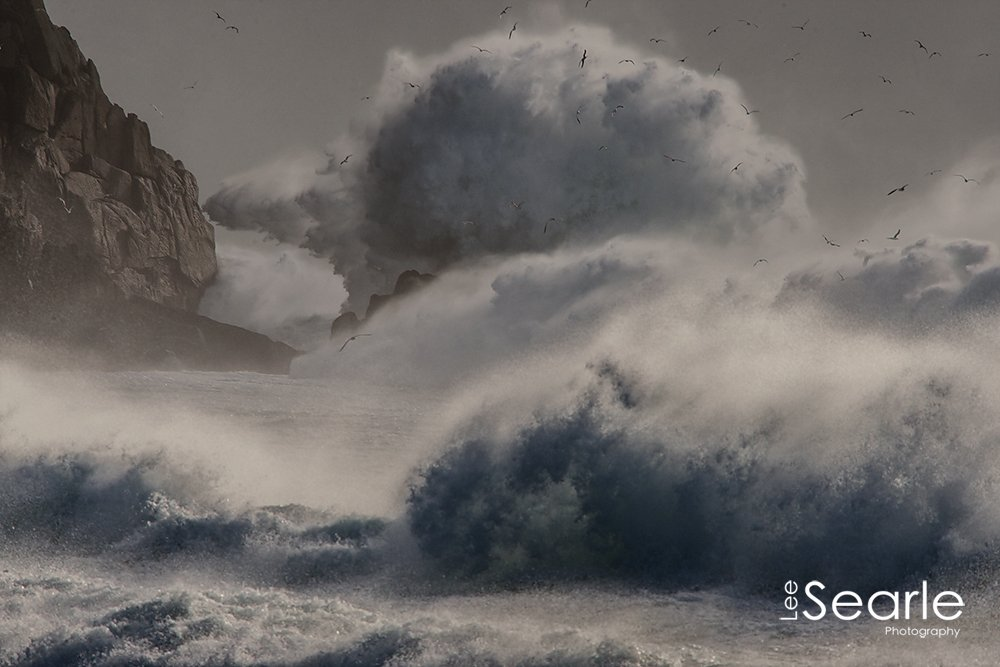 waves from storm imogen crash into the rocks on Porthcurno - photo © Lee Searle