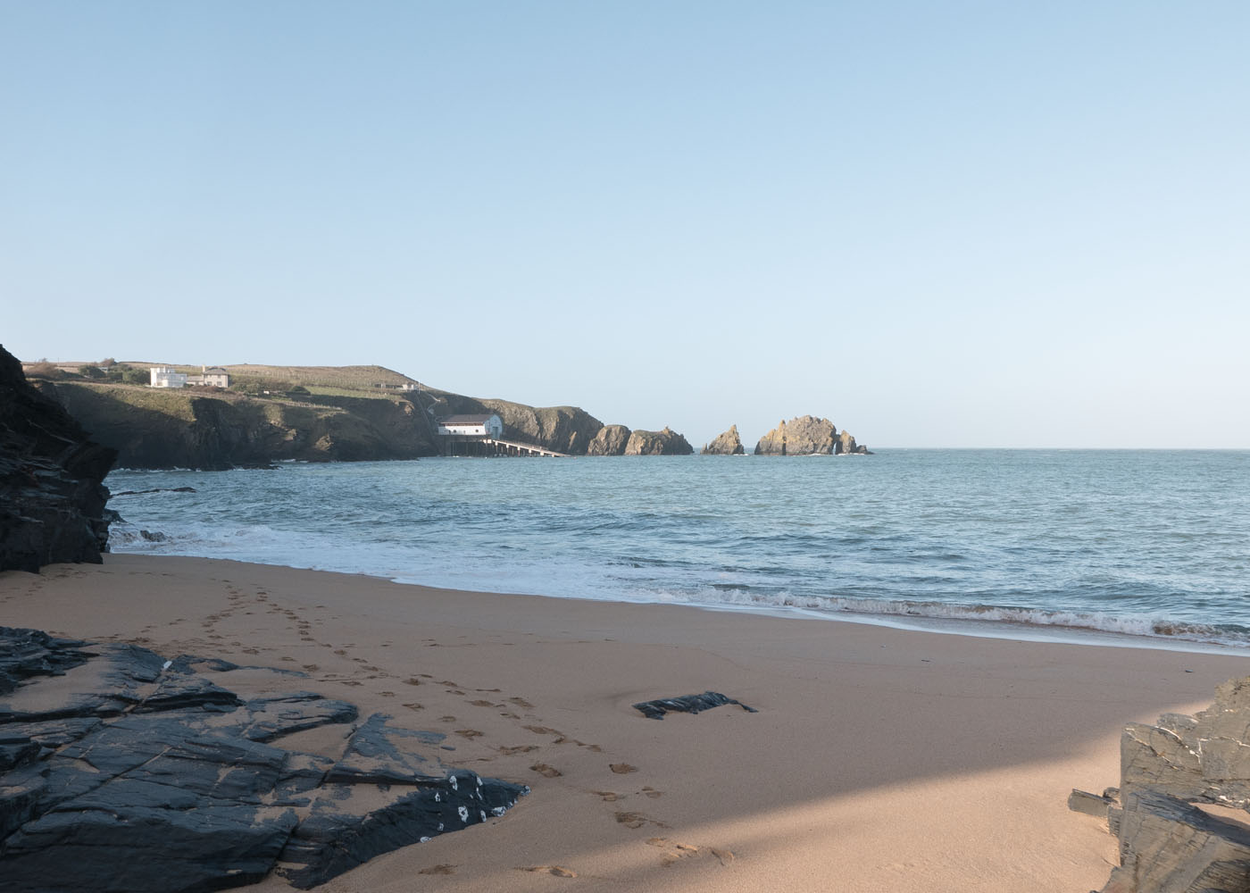 An empty Mother Iveys Bay beach looking towards the Padstow RNLI Lifeboat Station