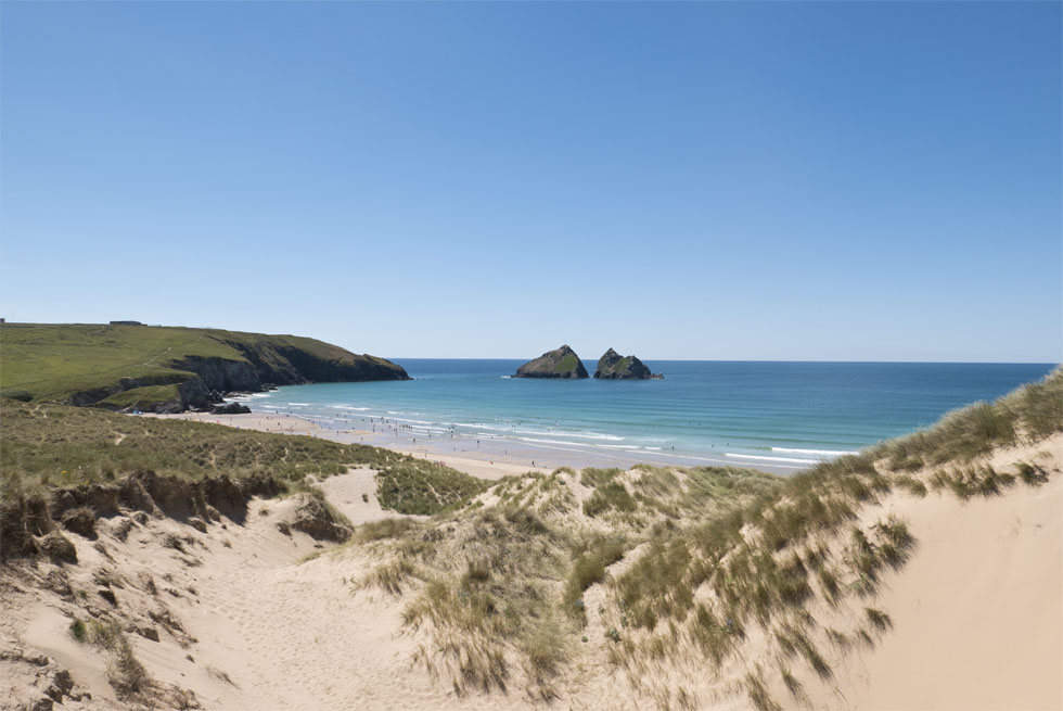 Views of Gull Rocks on Holywell Bay from the sand dunes