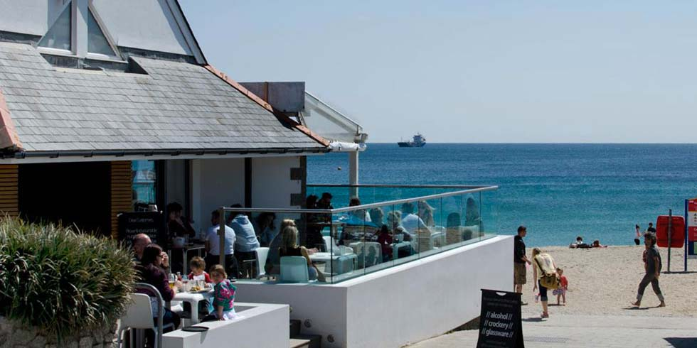 The view of Gylly beach cafe in Falmouth Cornwall