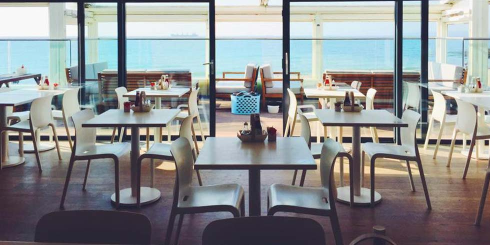 Modern interior of Gylly beach cafe in Falmouth
